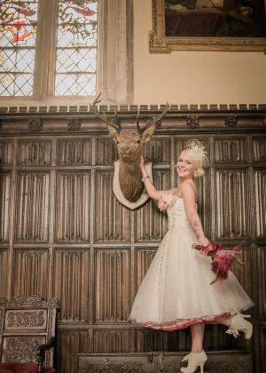 Image of the model next to a stag head