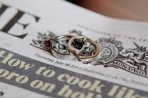 An image of two rings on a newspaper.
